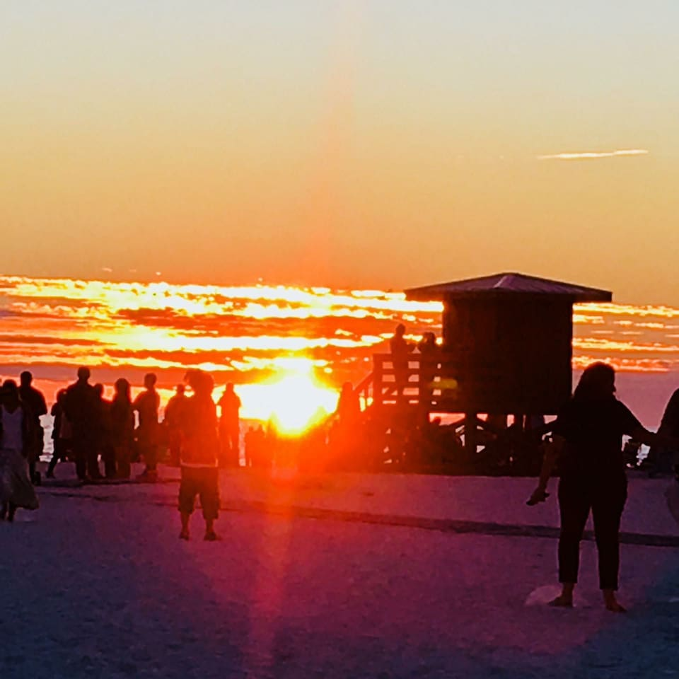 Siesta Key Beach has the best sunsets and softest sand you will ever feel. Drum circle every Sunday!