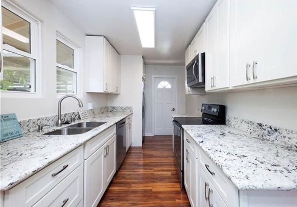 Complete full sized kitchen with updated appliances including dishwasher and ice maker with water filter in fridge.