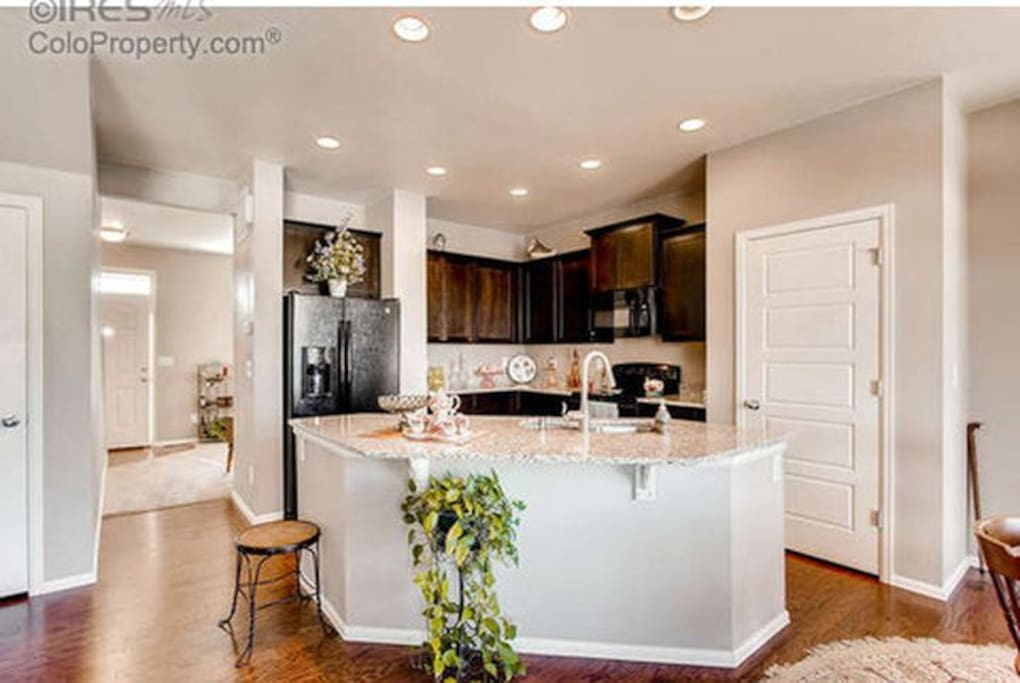 Open kitchen with granite tops and new appliances