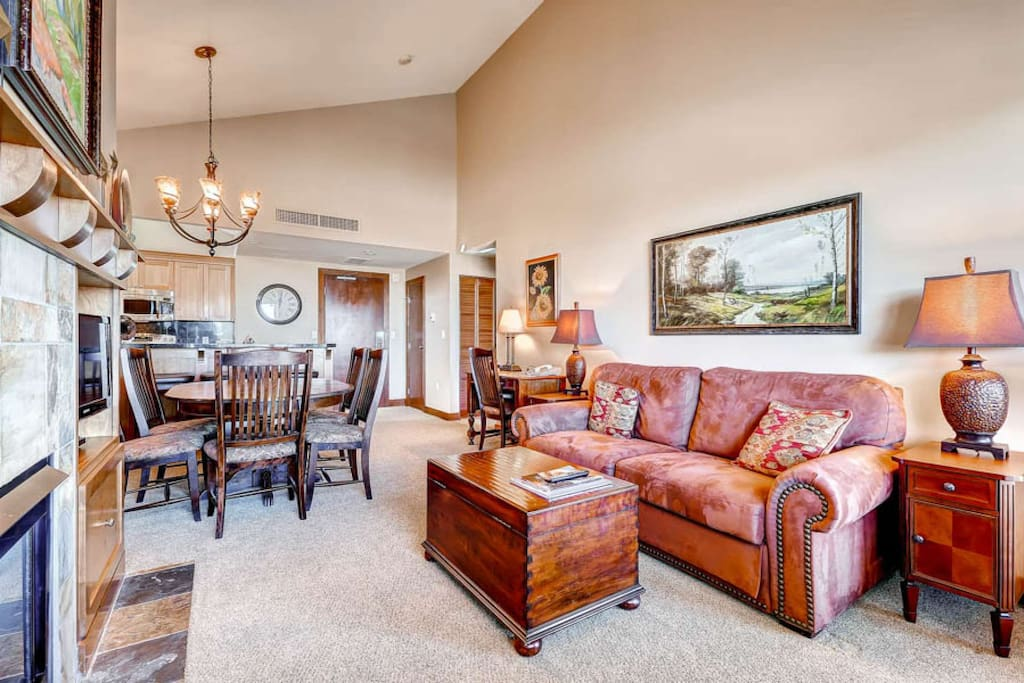 Living Room w Gas Fireplace / Vaulted Ceilings + Lots of Natural Light from the Large Windows