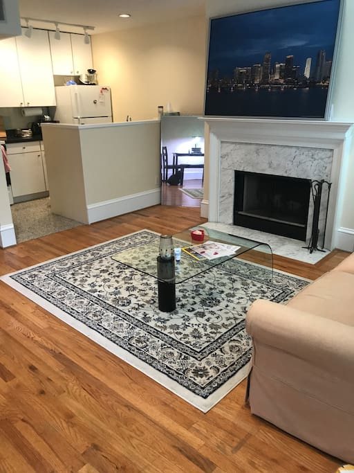Living/Kitchen Area couch has been moved and a large HD tv with Apple TV has been added