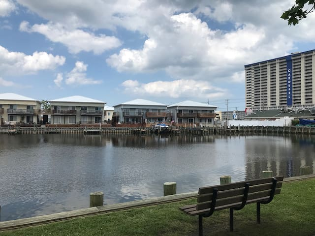 Sit and enjoy a beautiful canal view just feet from condo... right behind Greene Turtle restaurant/bar.