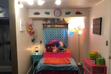 Twin bed 1/2 room shared w/ common area