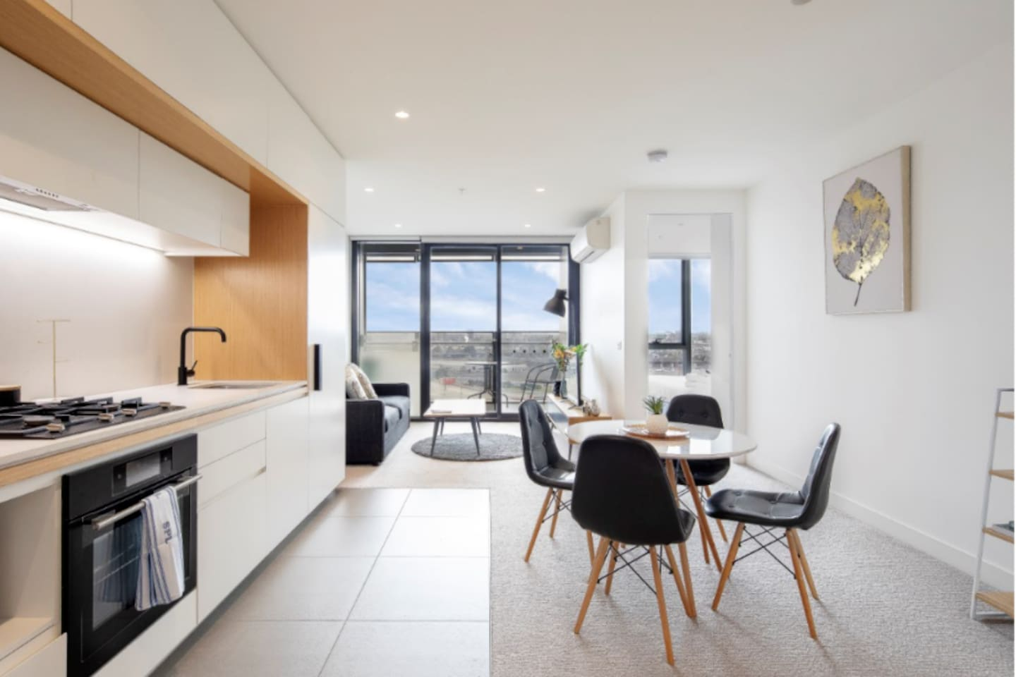 Bright and spacious open plan living and dining area with kitchen with a view of the amazing Docklands Star Wheel