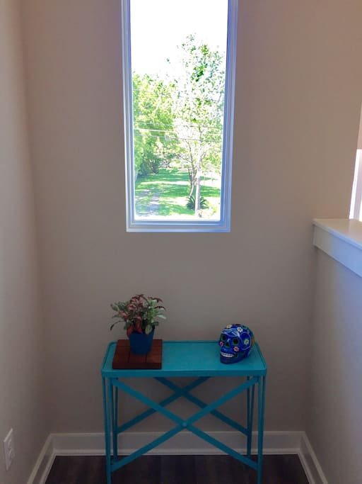 Just outside the room is a small area which can be used as a sitting space or small desk area. If you need me to provide you a table and chair let me know prior to your arrival and I am happy to do so!