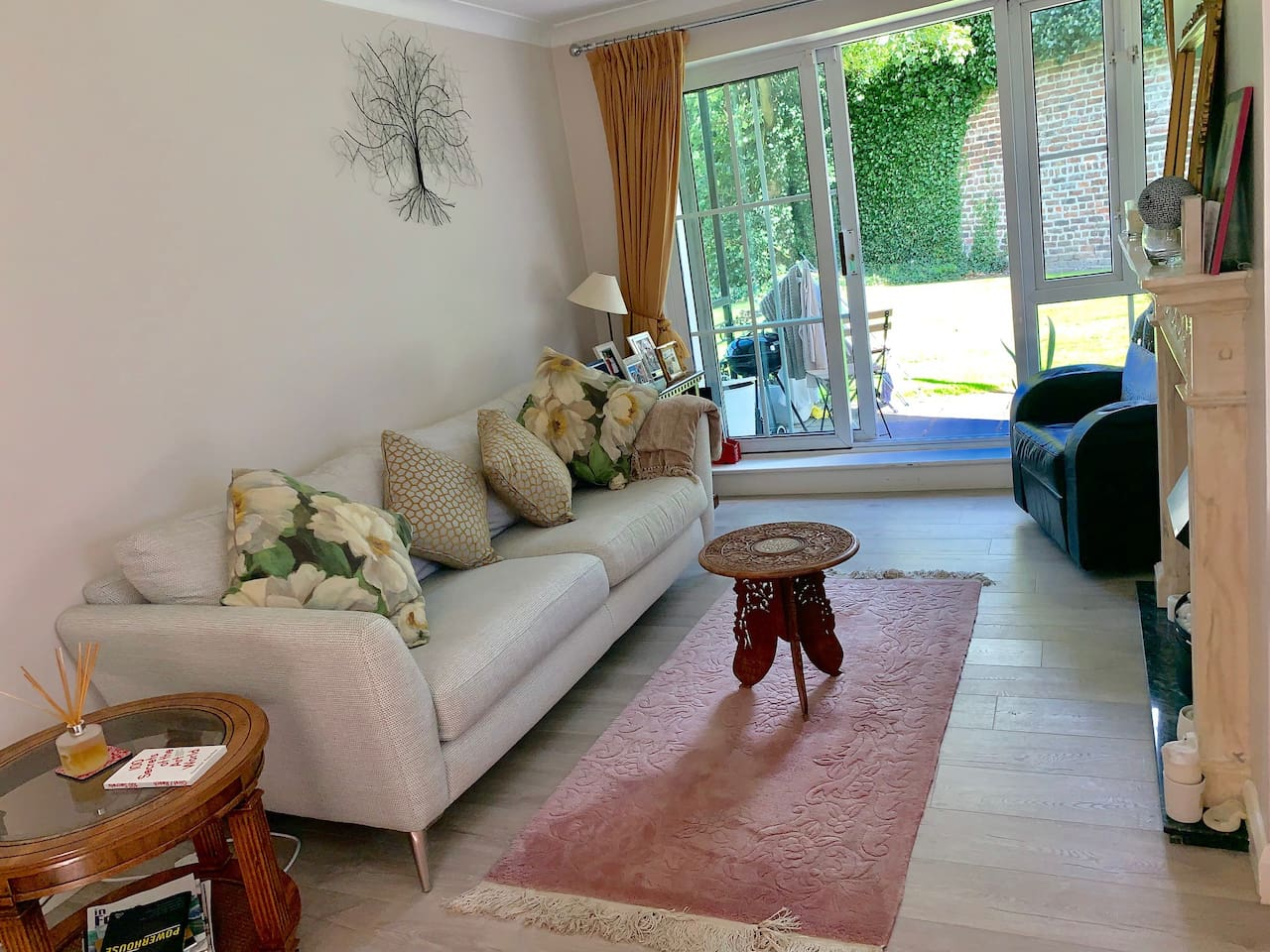 Living room with walled garden view, available during the day.