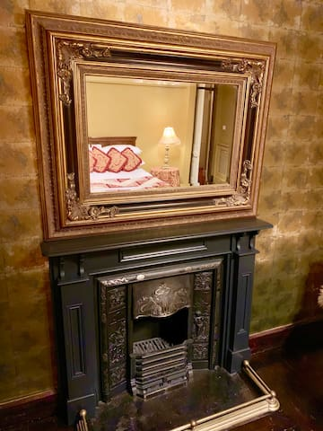 Double bedroom feature fireplace
