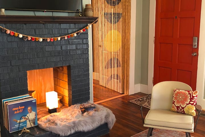 The fireplace hearth and Smart TV provide a focal point in the living room.