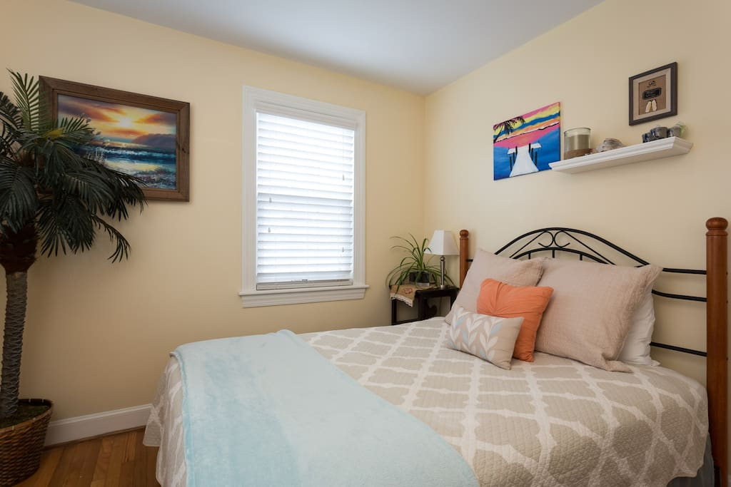 Your cozy bedroom full of local artwork.