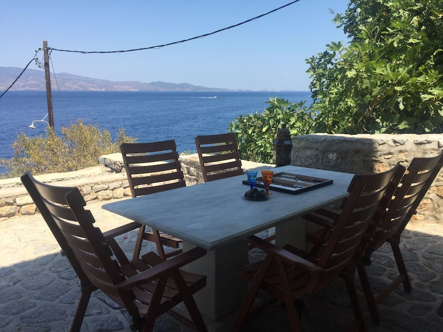 Outside dining table with wooden chairs