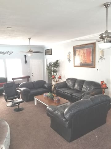 """Grand living room with fireplace, 65"""" Smart LED TV"""