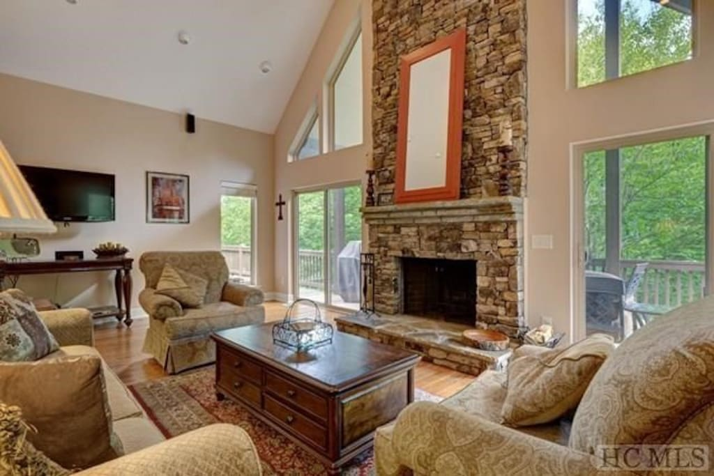 Huge great room with stone Fireplace and 25ft ceiling