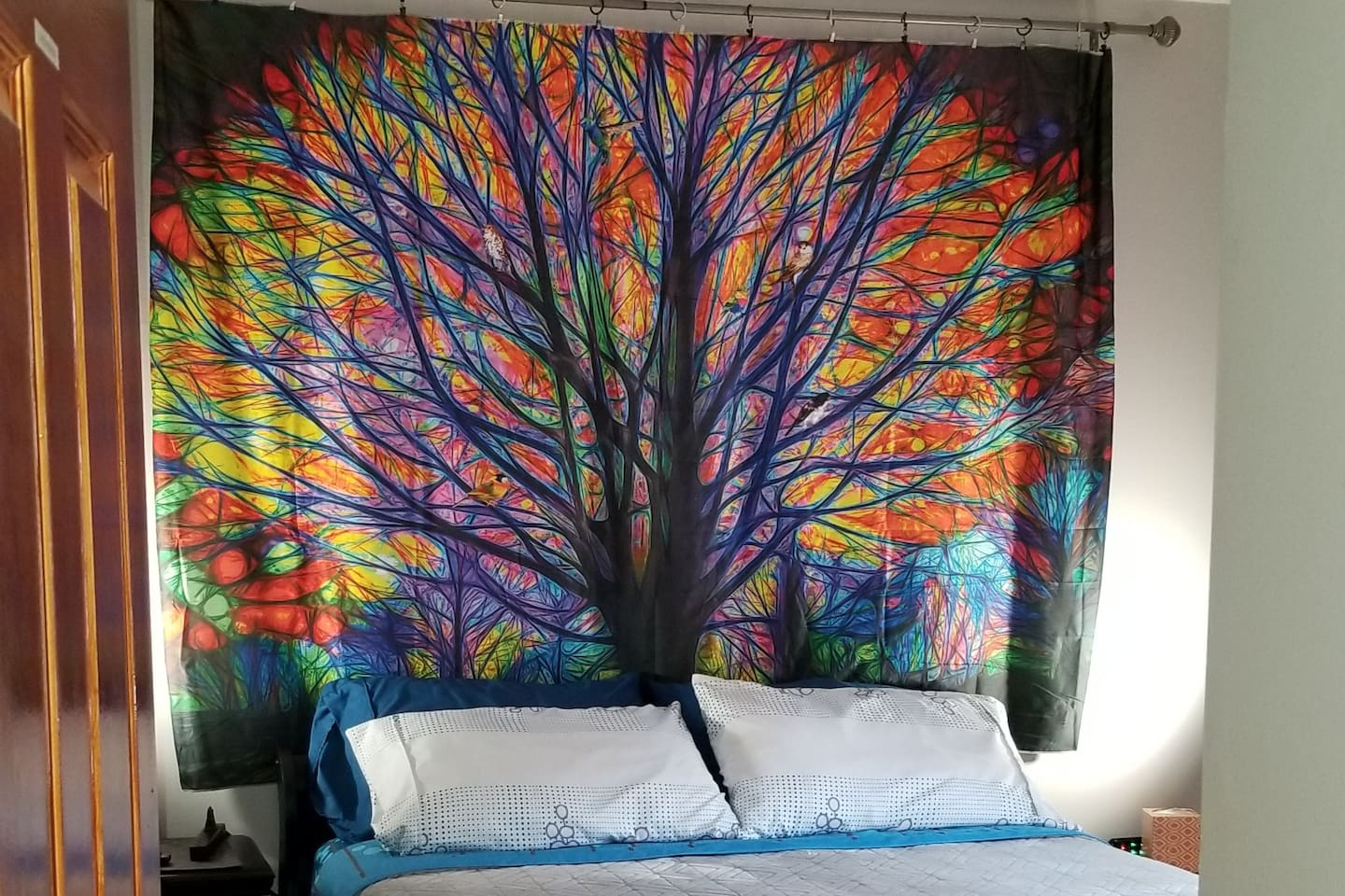 Queen bedroom with new tapestry on the wall.
