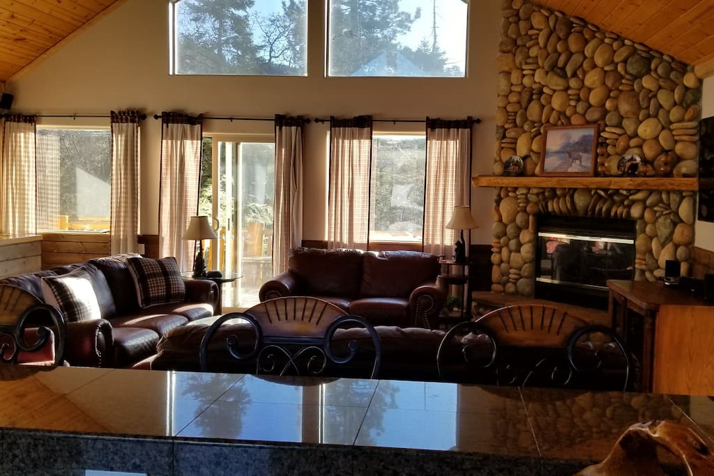 Huge Living Room with seats for all and bar off the kitchen. Deck off of living room.
