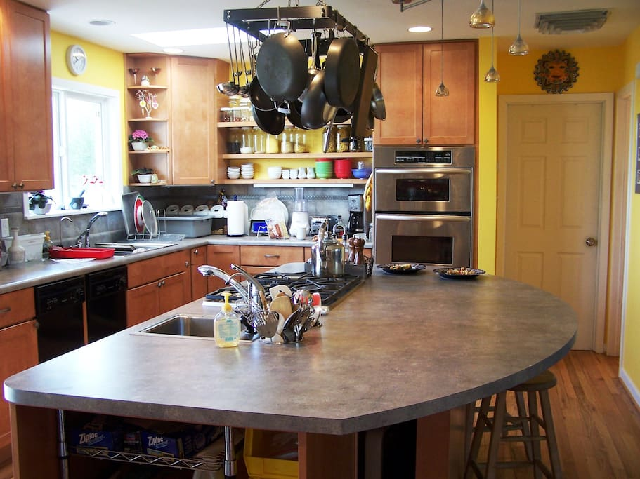 Light filled kitchen with 8 ft island and skylight. Lots amenities.