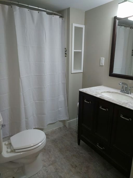 Full  3 piece bathroom with washer and dryer.
