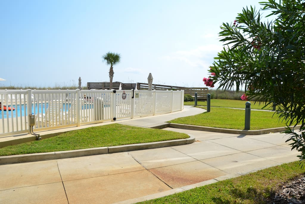 The pool is just a few steps outside our door, and the walkway to the beach is on the other side of the pool