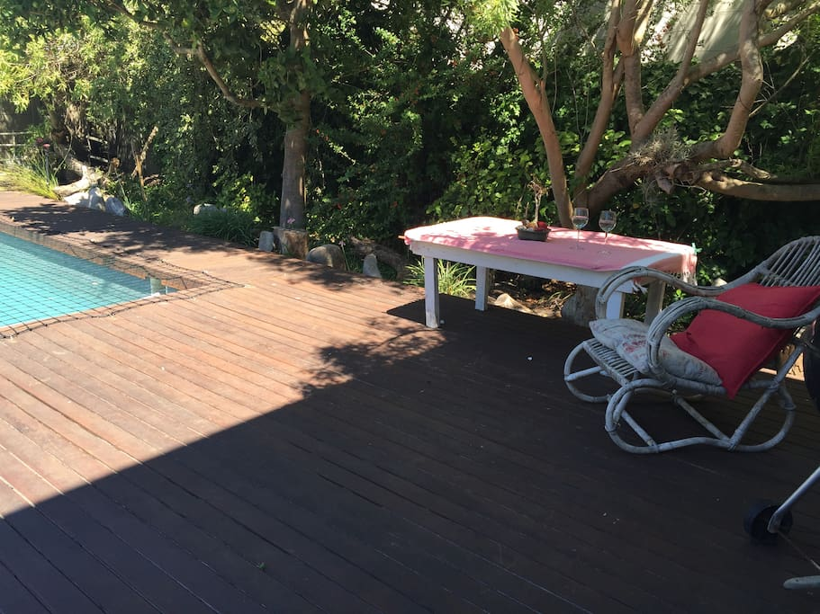 Shaded area by the pool to dine