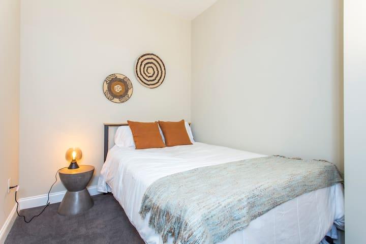Queen size bed, comfortable bedroom.