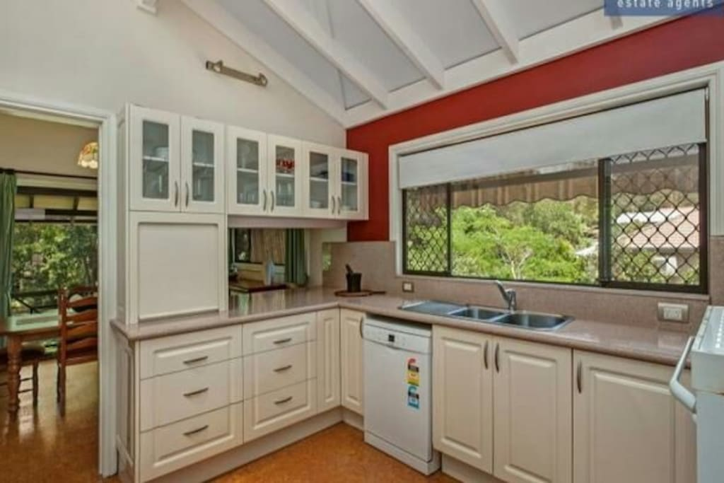 Well lit functional kitchen fully equipped.