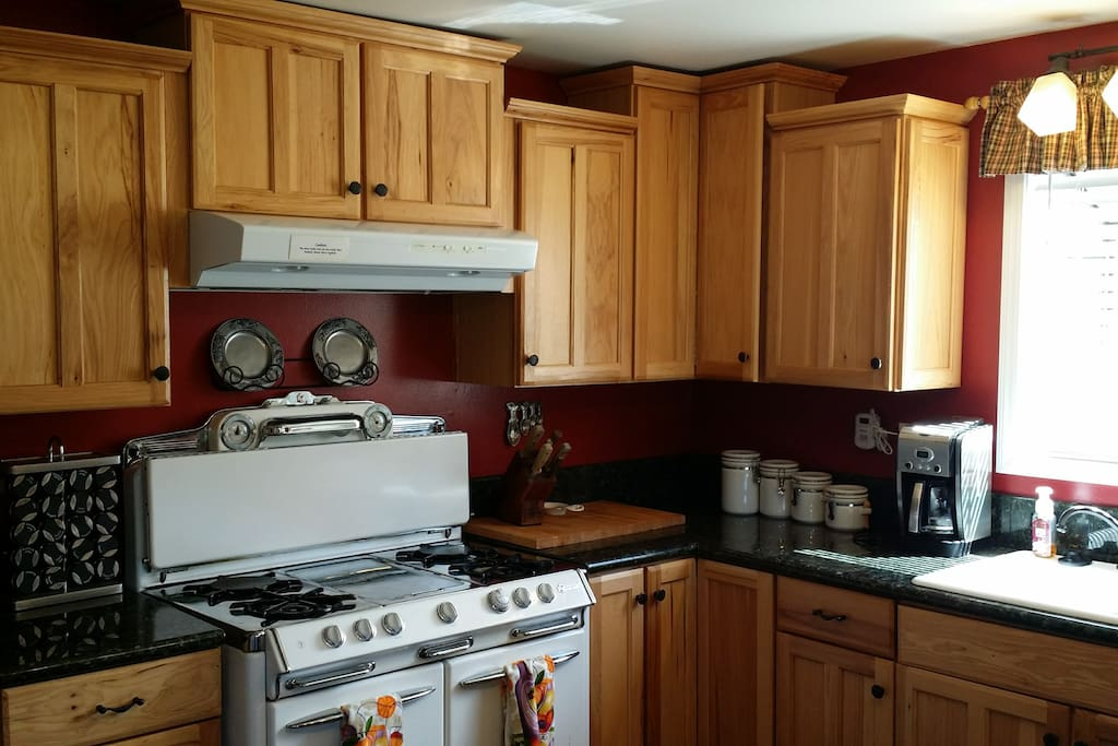 Large open kitchen with working antique stove