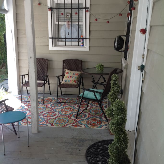 Relax on your private porch with festive lighting and a fan.
