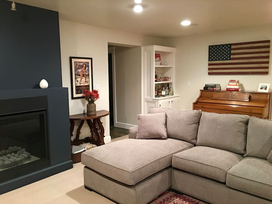 Two plush sofas, fireplace, and television make for a cozy living room.