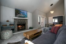A relaxing living room and dining area to entertain or watch television on the smart HDTV.