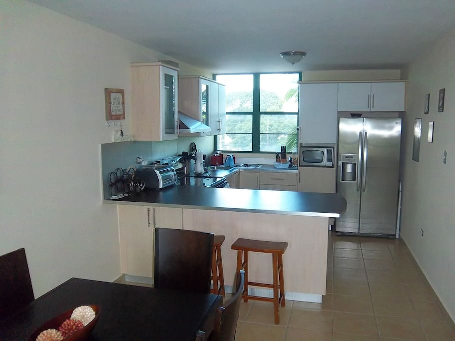 Fully equipped kitchen with side by side refrigerator