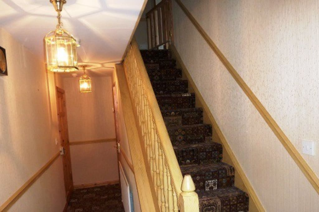Entrance hall and stairs. A downstairs toilet situated here as well.