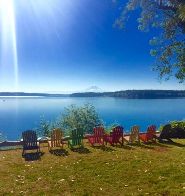 A rainbow of Adirondack chairs awaits you.