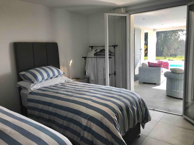 2nd Bedroom on ground floor with en-suite bathroom including Italian shower, vanity unit and toilet. The beds are hotel quality and can be prepared as 3' singles or Superking.