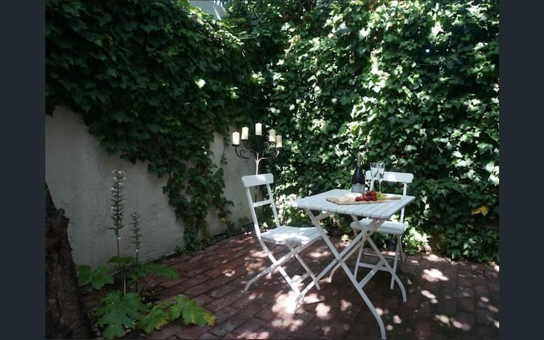 Your own private courtyard for a lazy brunch or a glass of wine in the dappled sunlight.