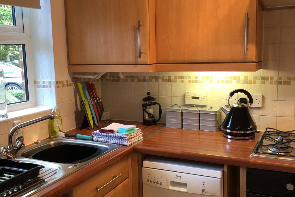 Compact kitchen with dishwasher, washer/dryer