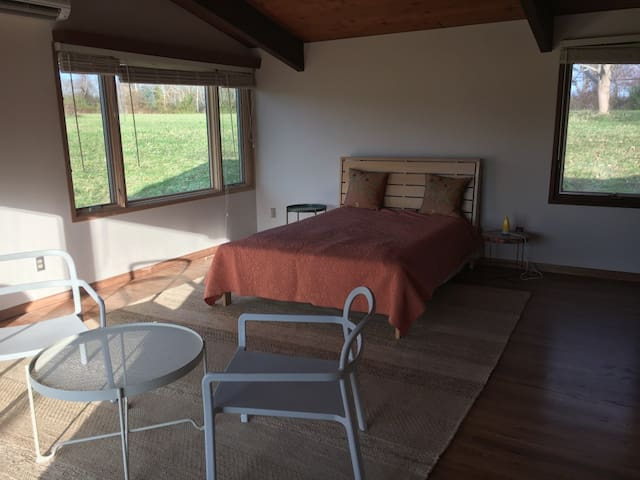 The main guest suite overlooks  Nonquit pond. It also features a private deck.