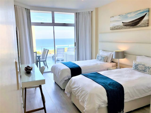Second Bedroom with two single beds Sea views