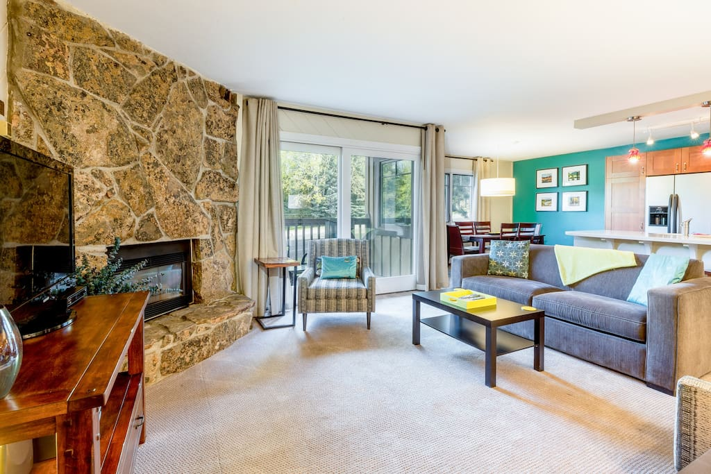 The living space comfortably seats 4 with a stone fireplace anchoring the room.