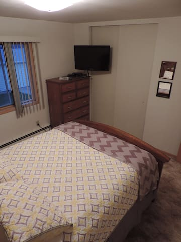 Bedroom #1 with queen bed and TV