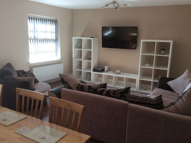 Large living area with amazing views dining area for 8 and TV