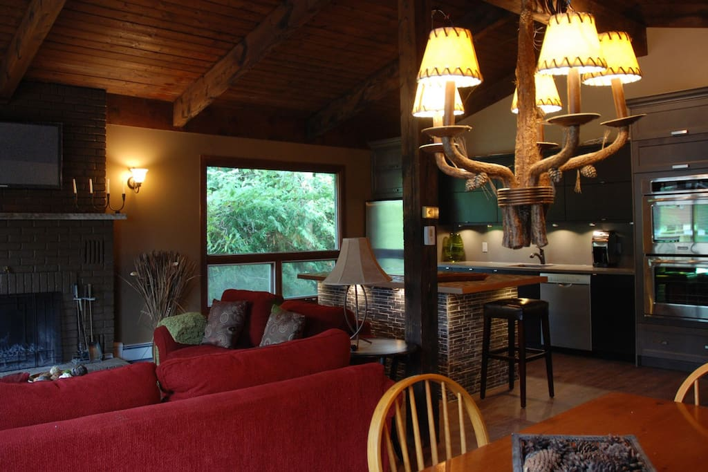 Great Room open concept with view of Ski Hill in winter off a Large Deck