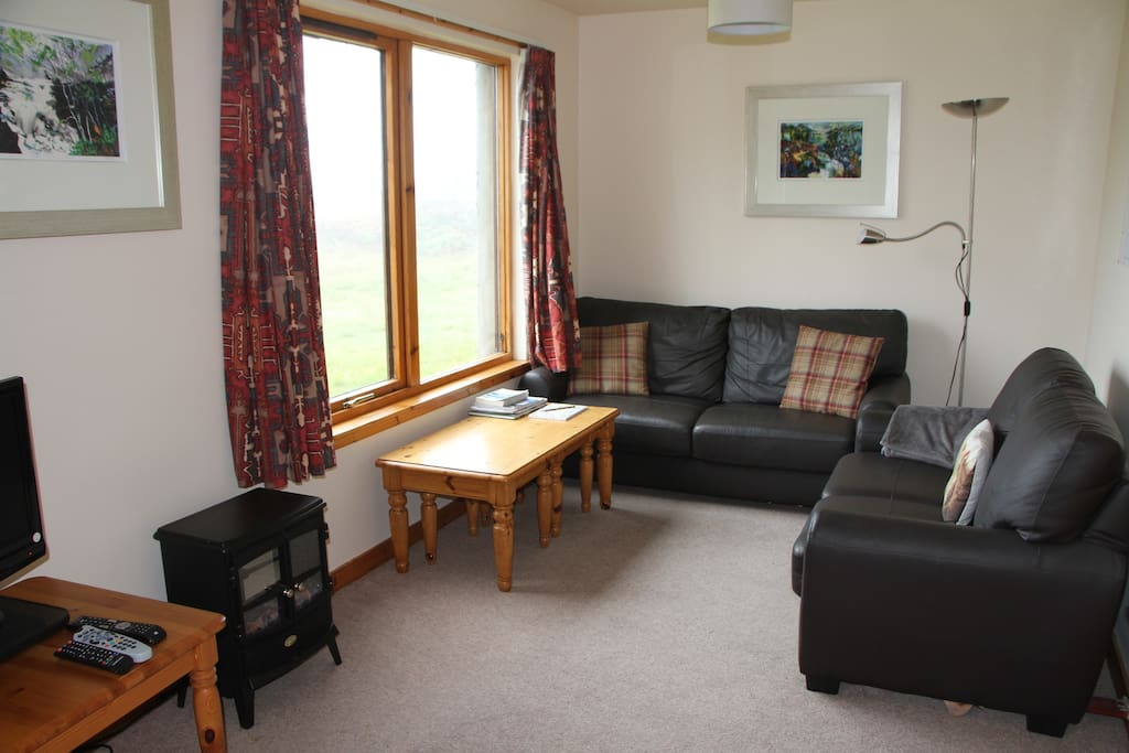 Cosy open plan living area with lovely views over Achmelvich Bay