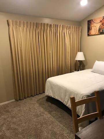 Cozy bedroom minutes away from beach