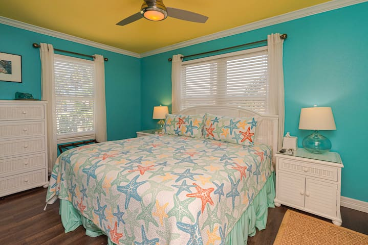 Master Bedroom- King Size Bedding with a Flat Screen TV