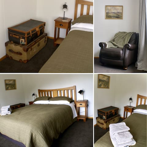 Guests bedroom with a very comfortable queen bed.