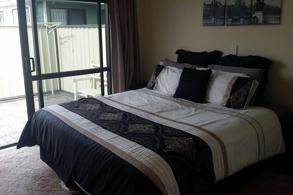Master bedroom with doors to courtyard