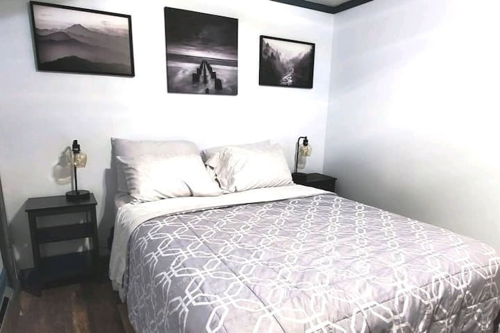 Queen size bed and 4 pillows with covers which are santinized in between bookings. There are two side tables and lamps with usb ports.