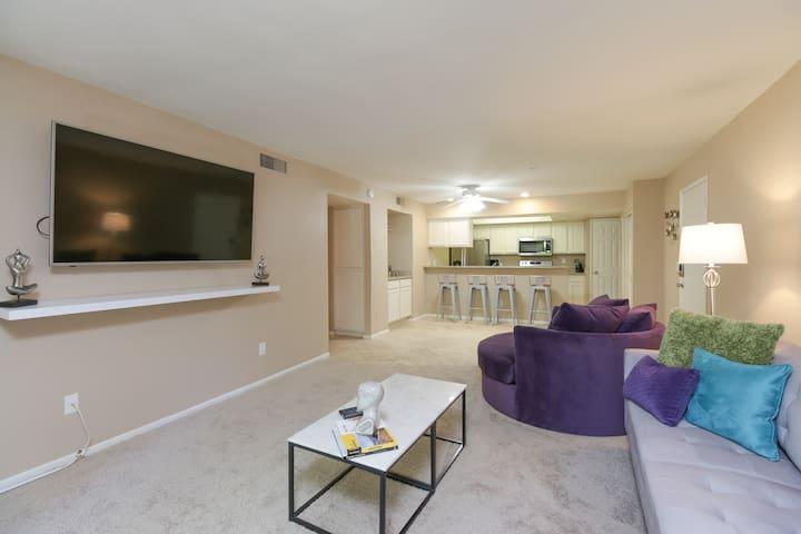 "spacious living room, 65"" smart TV"