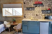 2nd kitchen is a fully accompanied kitchenette with small dining table