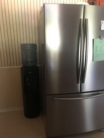 Bottled water and a full size refrigerator and freezer for your use.