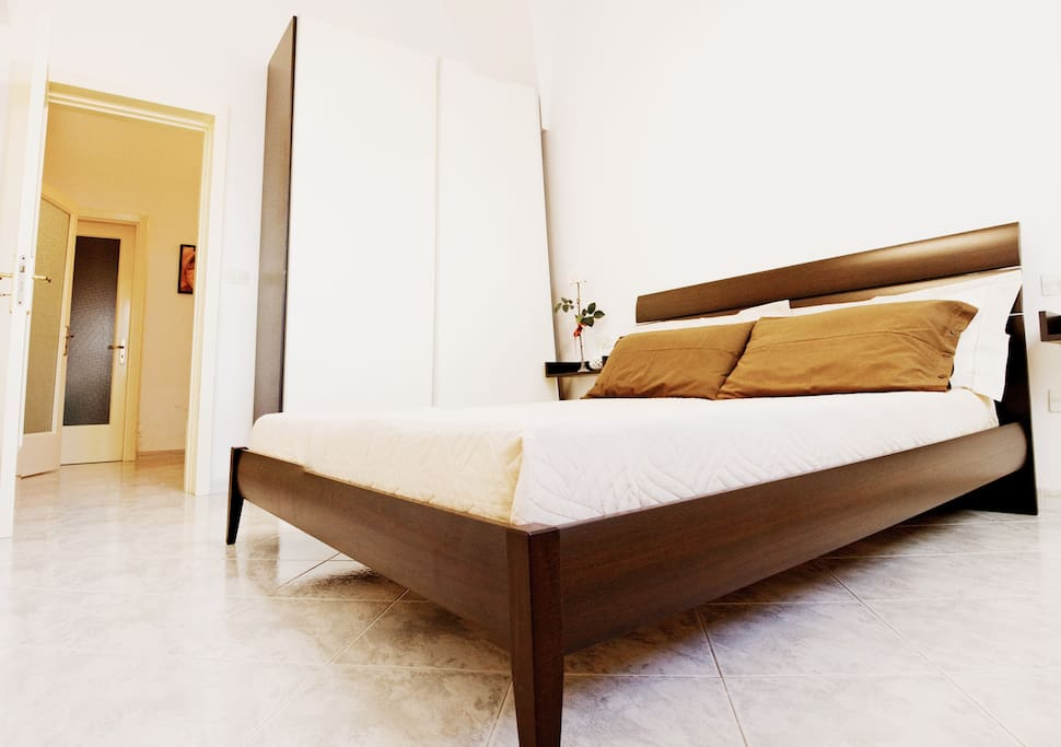Double bedroom with comfortable bed and large wardrobe